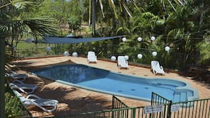 Seasonal outdoor pool, open 7 AM to 7 PM, pool loungers