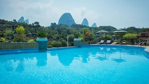 Outdoor pool, open 9:30 AM to 9:00 PM, pool umbrellas, pool loungers