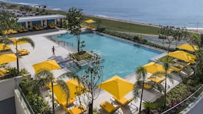 Outdoor pool, open 6 AM to 7 PM, pool umbrellas, pool loungers