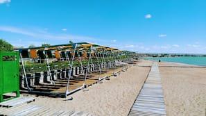 Private beach, beach umbrellas, fishing