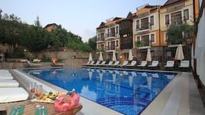 Seasonal outdoor pool, open 8:00 AM to 6:30 PM, pool umbrellas