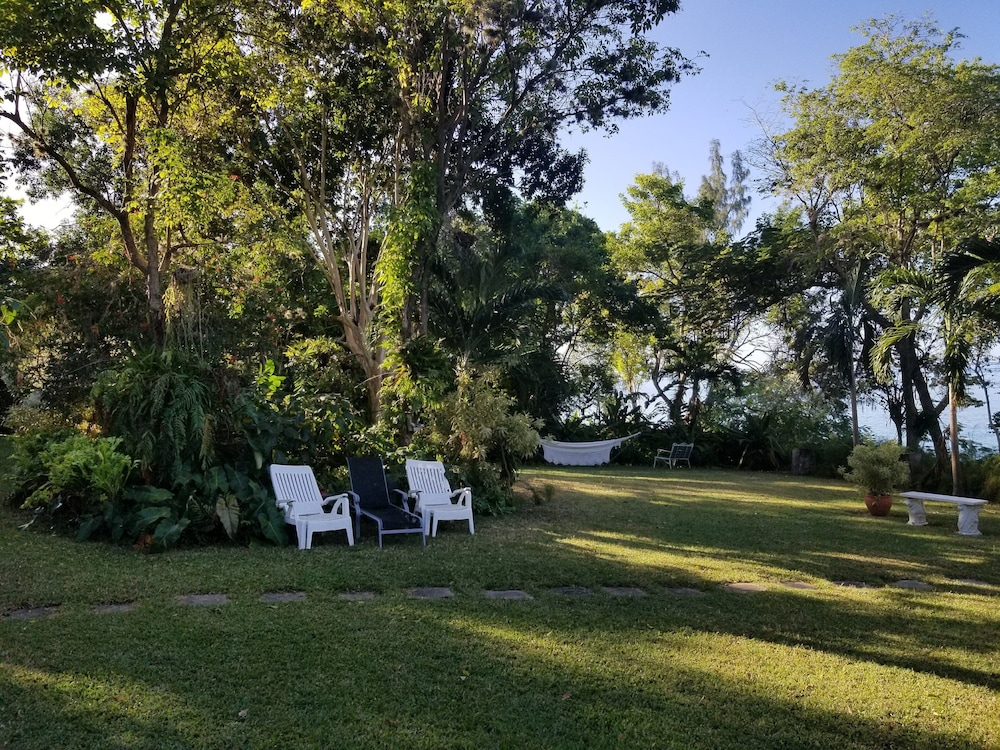 Oceanfront Guest House With Beautiful Gardens And Private Beach In