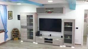 TV, console per videogiochi, libri, videoteca