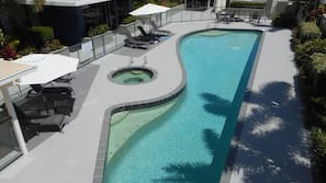 Outdoor pool, open 7 AM to 9 PM, free pool cabanas, pool umbrellas