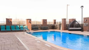 Seasonal outdoor pool, open 9 AM to 10 PM, free cabanas
