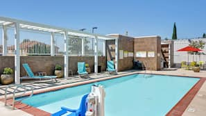 Outdoor pool, open 6 AM to 10 PM, pool umbrellas