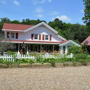 Restored Historical Farmhouse With Pond And Farm Animals At Mohican State Park