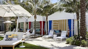 Outdoor pool, free pool cabanas, pool umbrellas