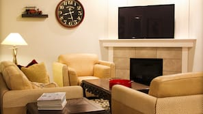 TV, fireplace, video-game console, books