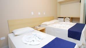 Roupas de cama premium, frigobar, Wi-Fi de cortesia, roupa de cama