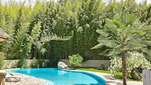 Seasonal outdoor pool, an infinity pool, pool loungers