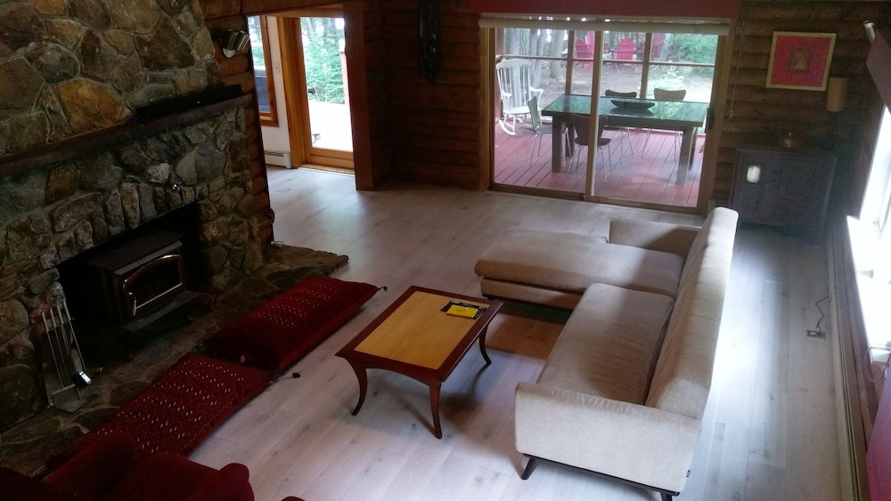 Living Room, Beautiful Lakefront log Home Nestled in the Pines