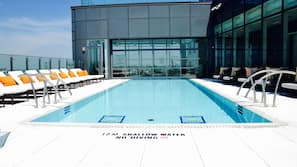Outdoor pool, open 6 AM to 10:00 PM, pool loungers