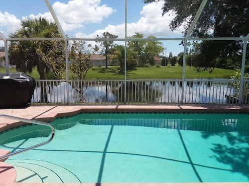 Serene Home On Saltwater Canal, Heated Pool.. Short Ride to Blue Water Beaches!