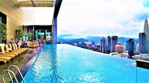 Outdoor pool, open 7:30 AM to 11:00 PM, pool loungers