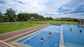 Outdoor pool, a natural pool, open 8:00 AM to 6:00 PM, pool umbrellas