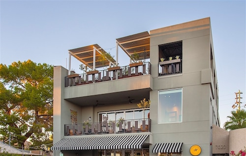 Check Expedia for Availability of Urban Living by RedAwning