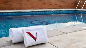 Outdoor pool, open 9:00 AM to 7:00 PM, pool umbrellas