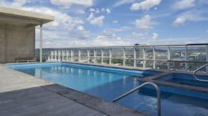 Seasonal outdoor pool, open 9:00 AM to 10 PM, sun loungers