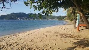 Beach nearby, white sand, beach towels