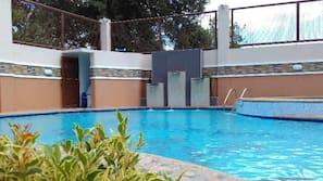 Outdoor pool, open 6 AM to midnight, free cabanas, pool umbrellas