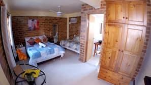4 dormitorios, minibar, cortinas opacas y tabla de planchar con plancha