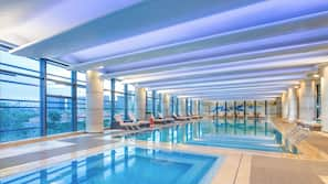 Indoor pool, open 7:30 AM to 11:00 PM, pool loungers