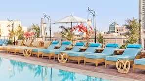 Outdoor pool, open 10 AM to 6 PM, cabanas (surcharge), pool umbrellas