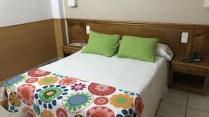 Caja fuerte, escritorio, wifi gratis y ropa de cama