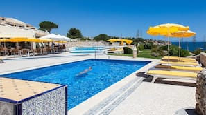 2 outdoor pools, open 9 AM to 7 PM, pool umbrellas, pool loungers