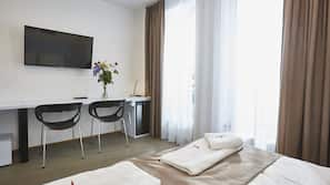 Minibar, desk, blackout drapes, iron/ironing board