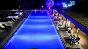 Outdoor pool, open 7 AM to 9 PM, pool umbrellas, pool loungers