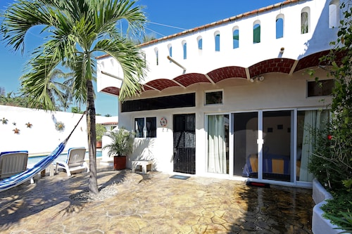 1/2 Block to Beach! Two Units Surrounding Gardens and Pool!