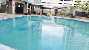 Outdoor pool, open 9 AM to 7 PM, pool umbrellas, sun loungers