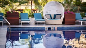 Outdoor pool, open 7:00 AM to 9:00 PM, free pool cabanas, pool loungers