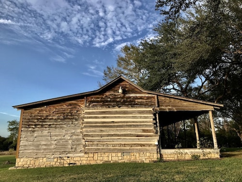 Relive History in an 1850's era Log Cabin With Modern Amenities