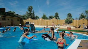Seasonal outdoor pool, open 8 AM to 6 PM, pool loungers