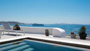 Outdoor pool, a rooftop pool, pool umbrellas, sun loungers
