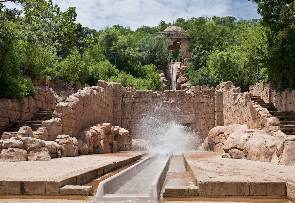 Waterslide, Bush Bungalows at Sun City Resort