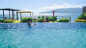 2 outdoor pools, an infinity pool, open 6 AM to 10 PM, pool umbrellas