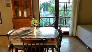 Full-sized fridge, microwave, cookware/dishes/utensils