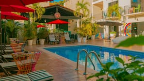 Outdoor pool, open 9:00 AM to 9:00 PM, pool umbrellas, sun loungers