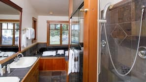 Separate tub and shower, jetted tub, hair dryer, bathrobes