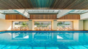 Indoor pool, open 6 AM to 10 PM, sun loungers, lifeguards on site