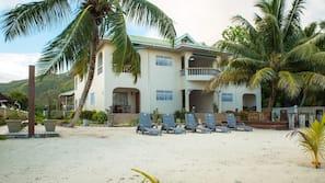 On the beach, white sand, beach towels