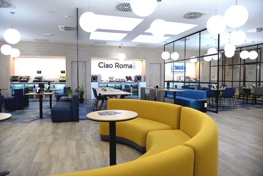 Living Area, Air Rooms Rome Airport by HelloSky