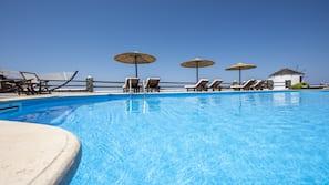 Seasonal outdoor pool, open 9:00 AM to 7:30 PM, pool umbrellas