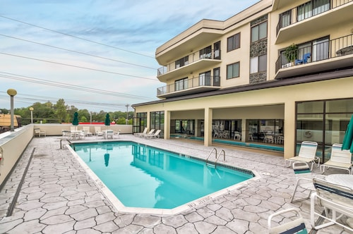 Great Place to stay Walk to Beach From Saside Escape w/a Shared Pool & Peek-a-boo Ocean Views near Ocean City
