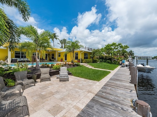 Great Place to stay Waterfront 3BR Island Home With Sun Deck, Private Hot Tub & Pool near Deerfield Beach