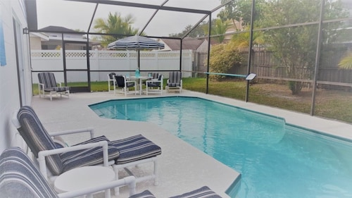 Great Place to stay Spacious 2-bedroom Kissimmee/disney Area Pool Home With Privacy Fence & Free Wifi! near Kissimmee